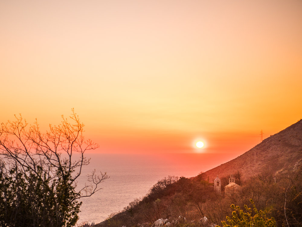 The sun sets over the Adriatic Sea near Zukovica, Montenegro.
