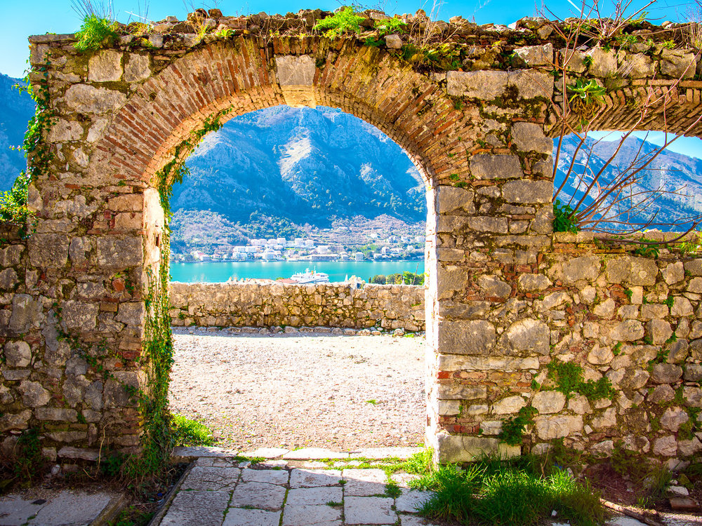 Looking through the arches of a ruin on the mountain over Kotor, Montenegro on the way to Our Lady of Remedy.