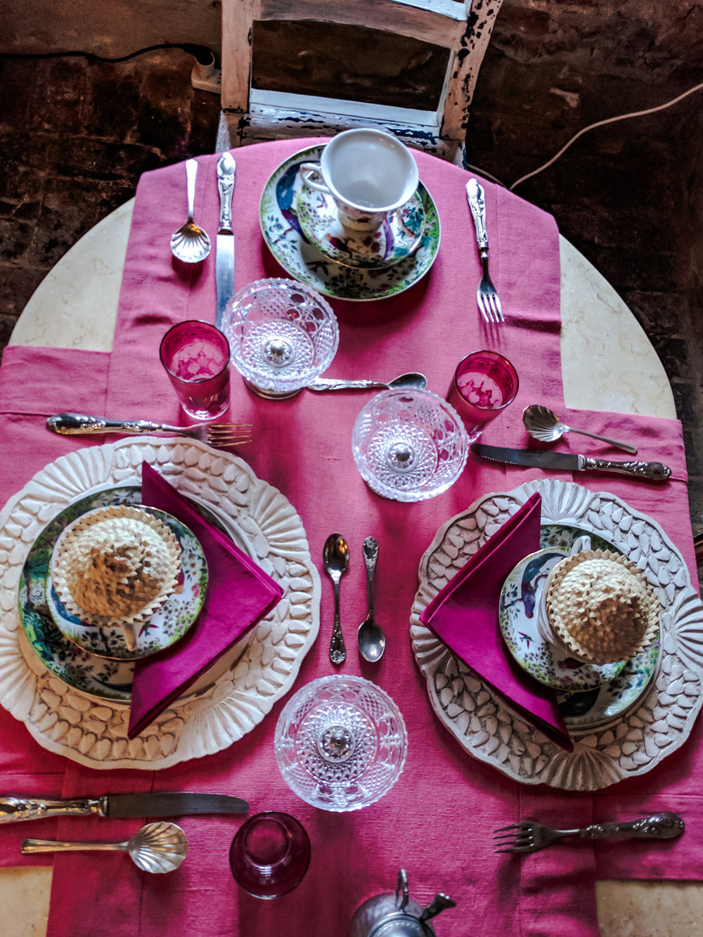 Table settings in the dining hall of Glamping Canonici Di San Marco.