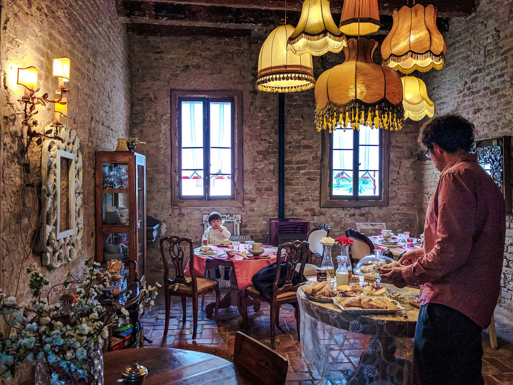 Breakfast is served in the dining room at Glamping Canonici Di San Marco.
