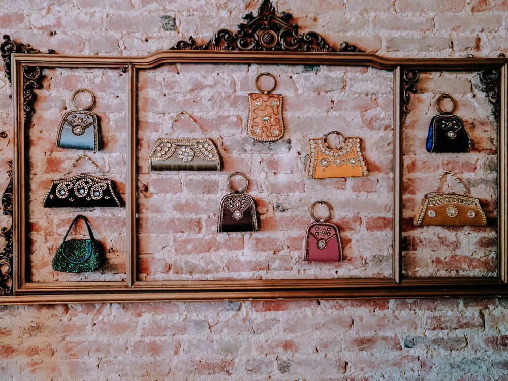Decorative purses hanging on a wall in a picture frame near Venice, Italy.