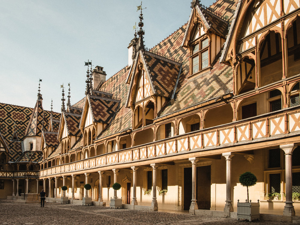 The famous patterned rooftops of the hospice museum in Beaune, France.