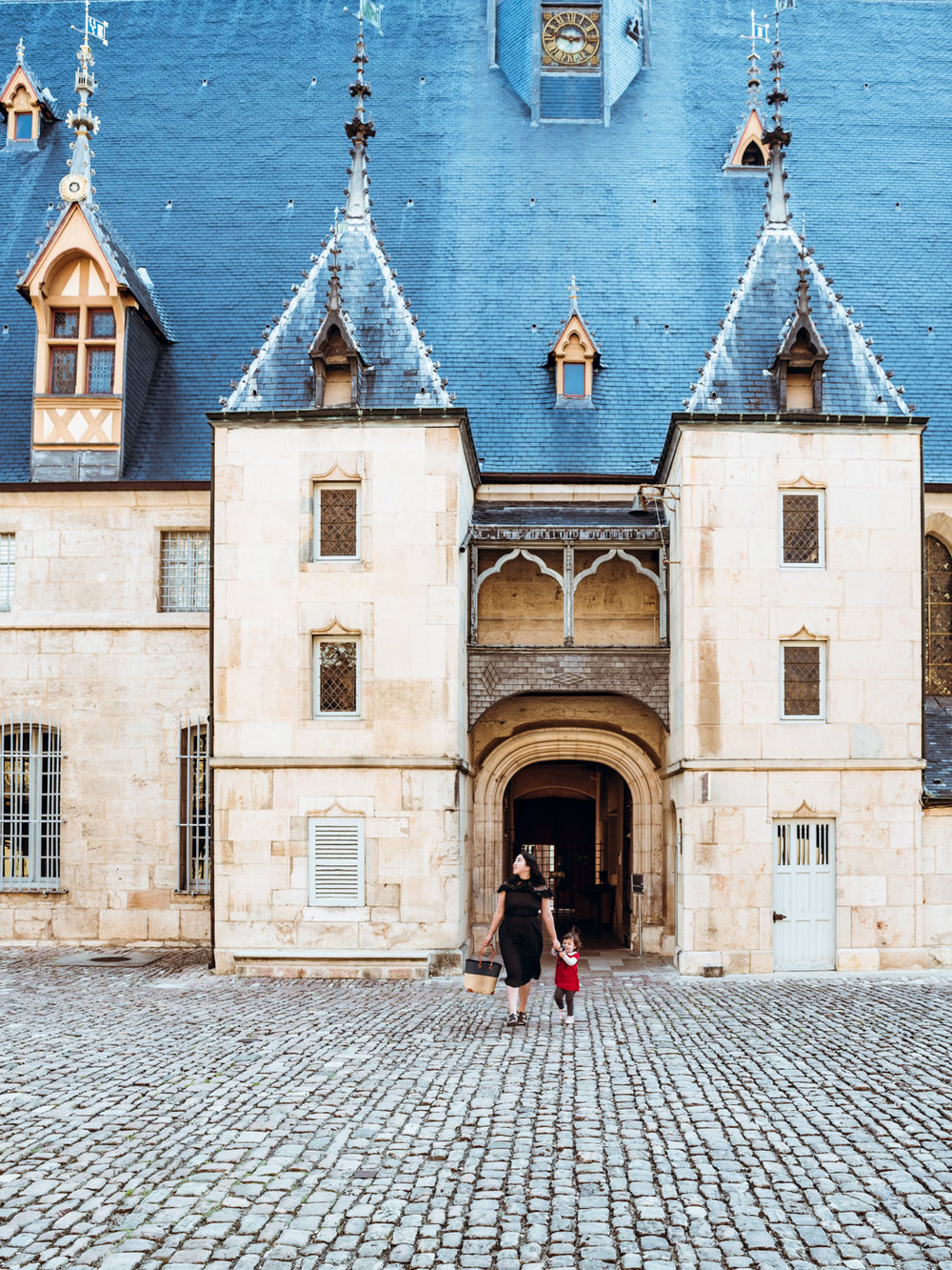 Walking into the hospices in Beaune, France.