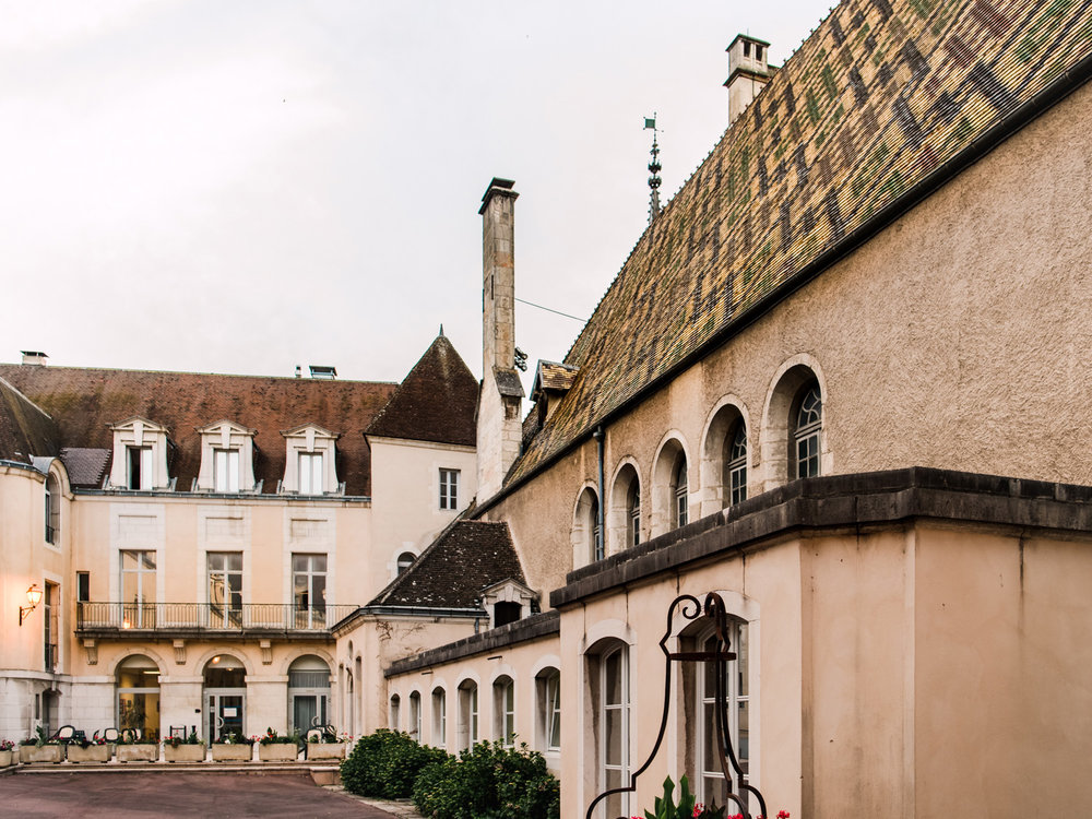 A lovely courtyard in Beaune, France, surrounded by those cool rooftops.