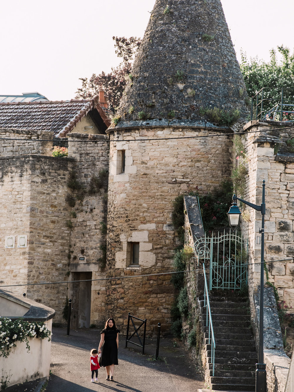 Walking past a beautiful old stone tower in Beaune, France.
