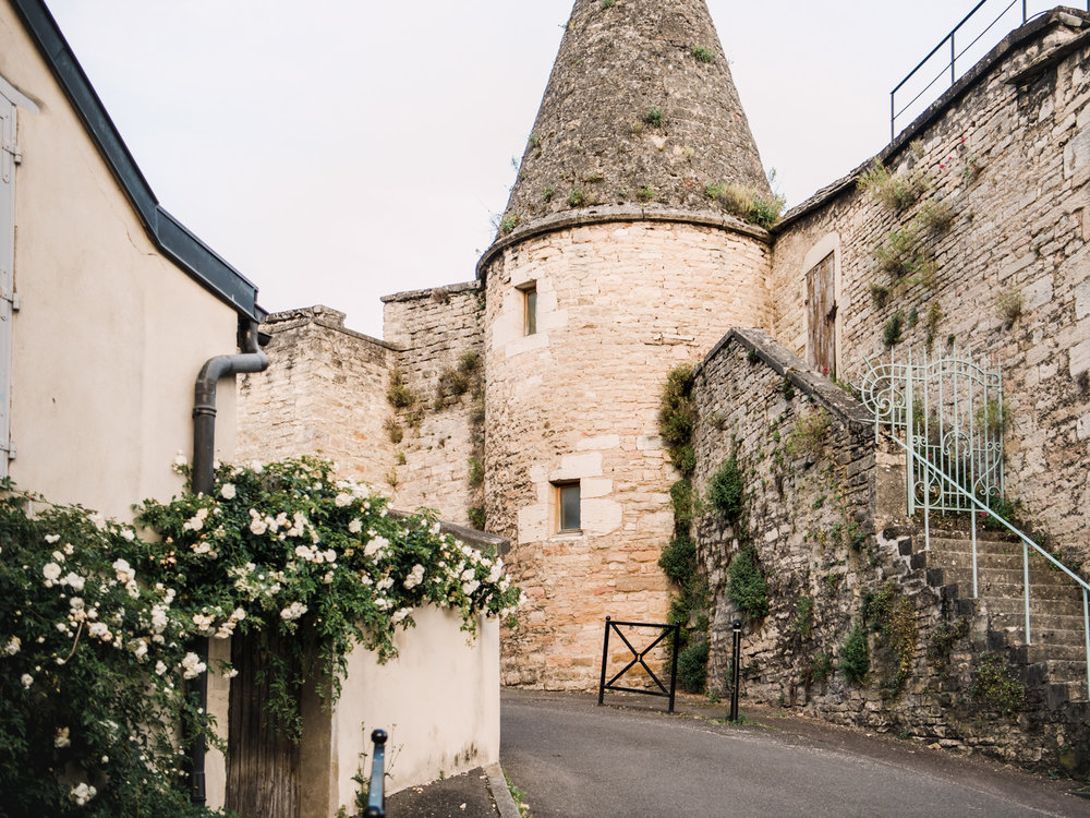 An old stone tower on the walls of Beaune, France. A great place for photography on our roadtrip from Paris to Avignon.