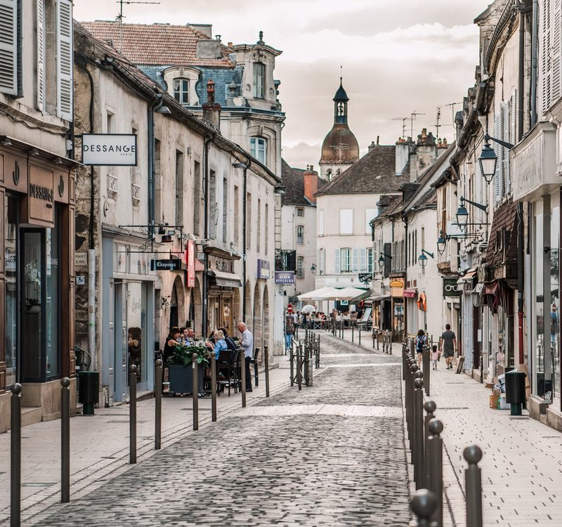 A beautiful cobblestone street in Beaune, France, our overnight stop on our roadtrip from Paris to Avignon.