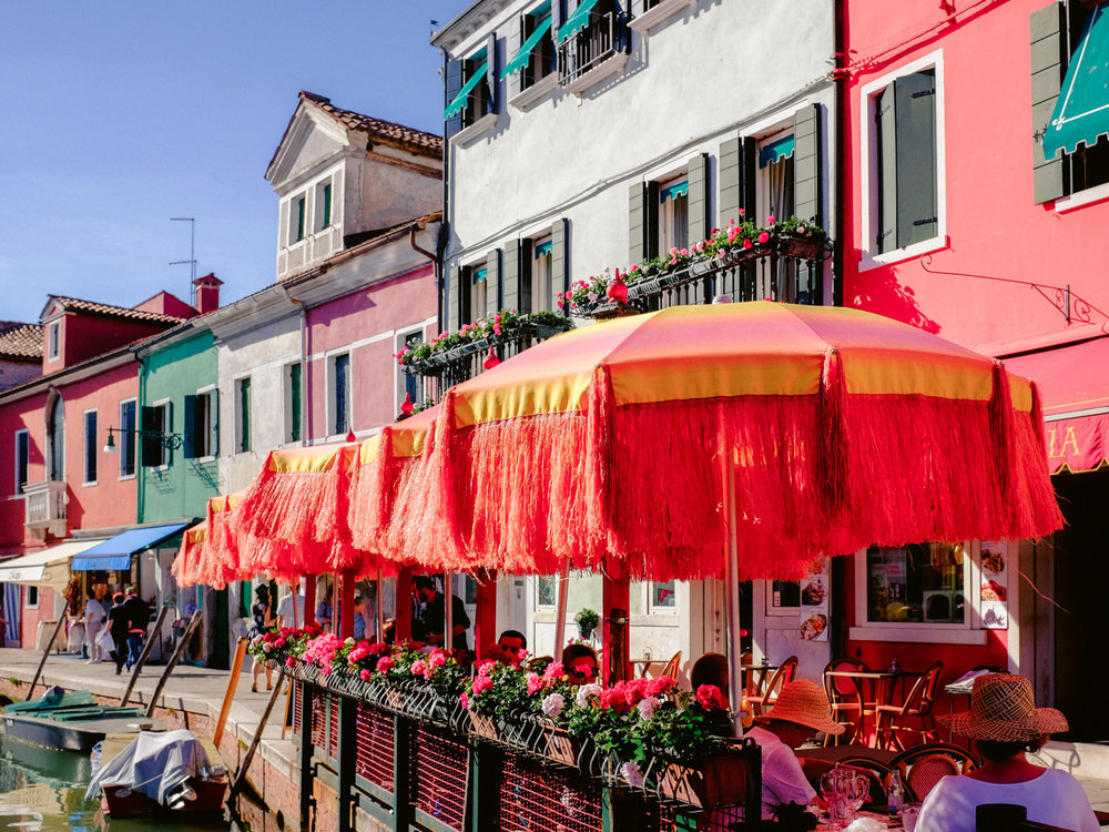 On the island of Burano, near Venice, Italy, even the cafe's are colorful.