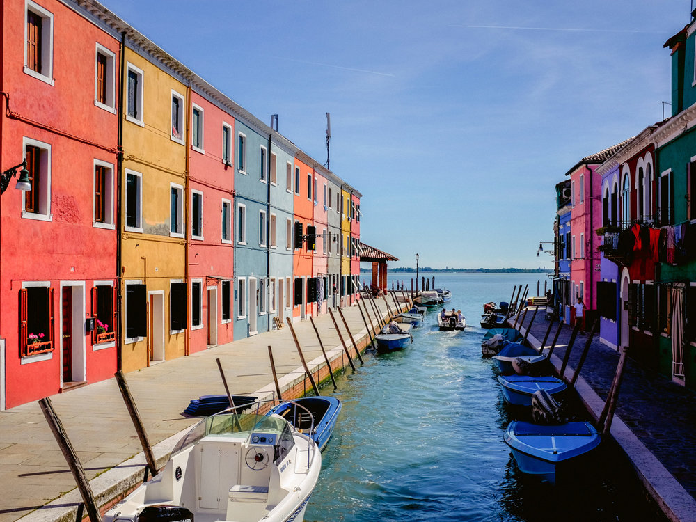 Burano, an island near Venice is a beautiful rainbow for travel photography enthusiasts.