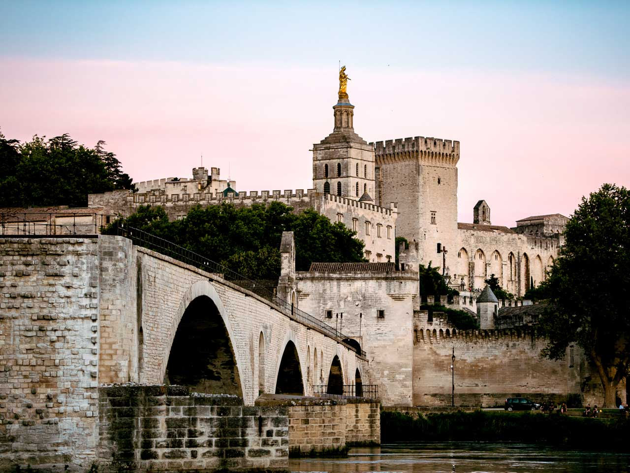 The Beautiful Pont D'Avignon the Palais des papes at sunset in the south of France.