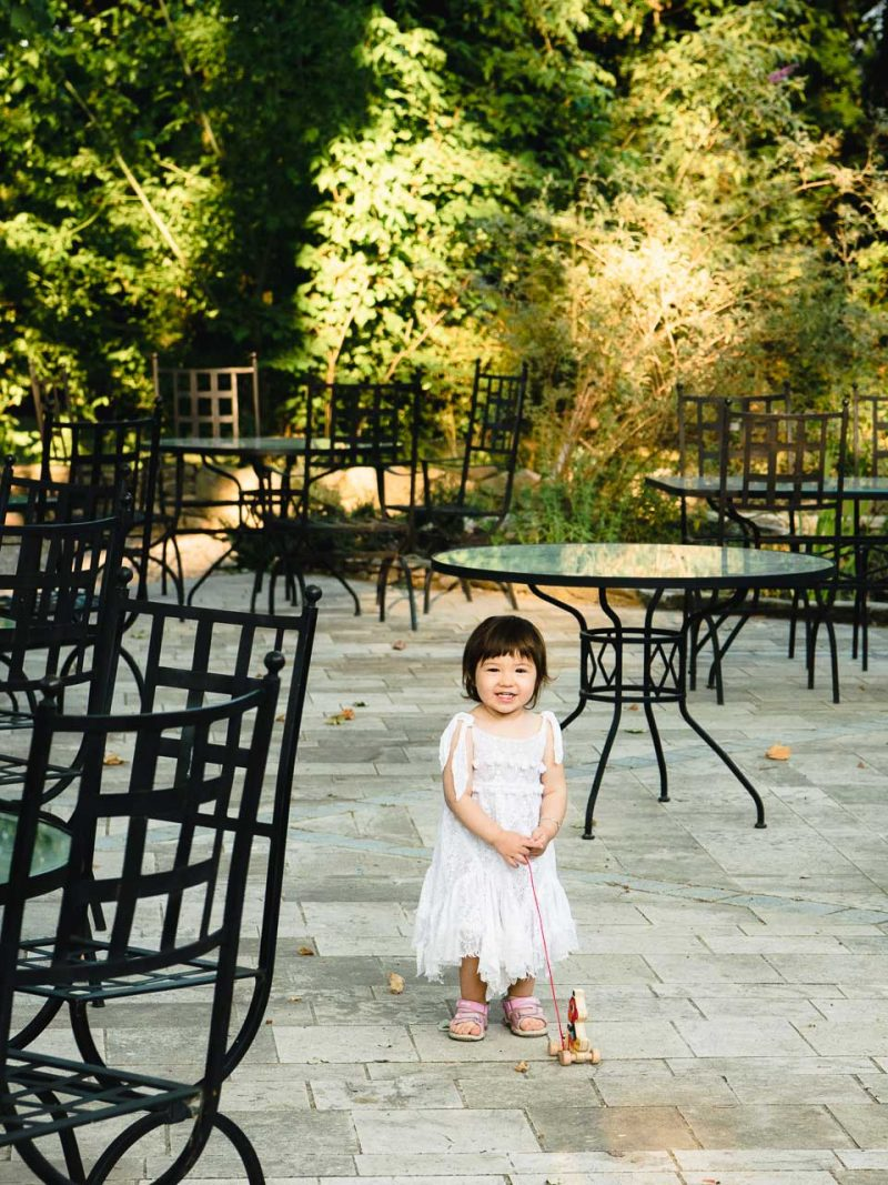 Lisa playing among the picnic tables in the La fuste courtyard.
