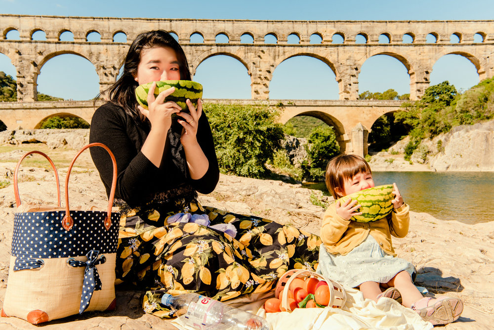 Enjoying some watermelon in front of the aqueduct at our pont du Gard picnic.