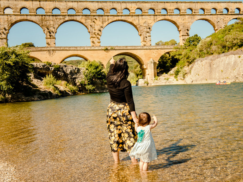Wading in the water in front of the pont du Gard aqueduct.