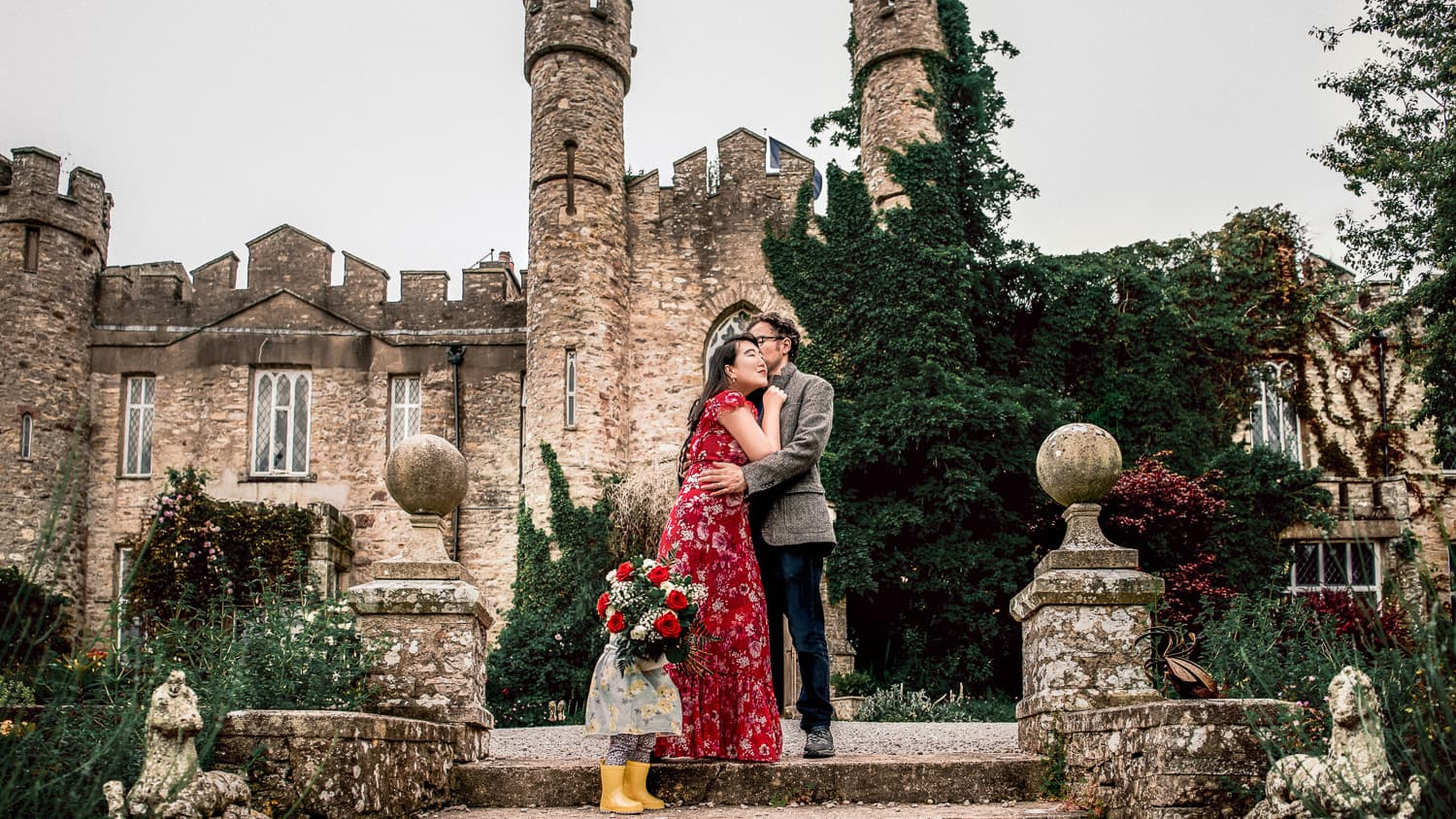Kissing in front of the English castle Airbnb we stayed at for our anniversary.