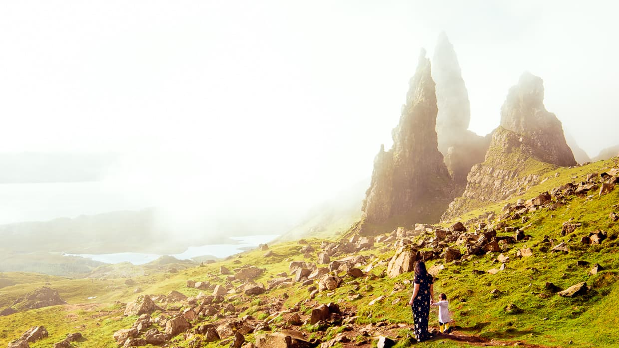 fog rolls in around the stone pillars of the old man of storr on the isle of Skye.