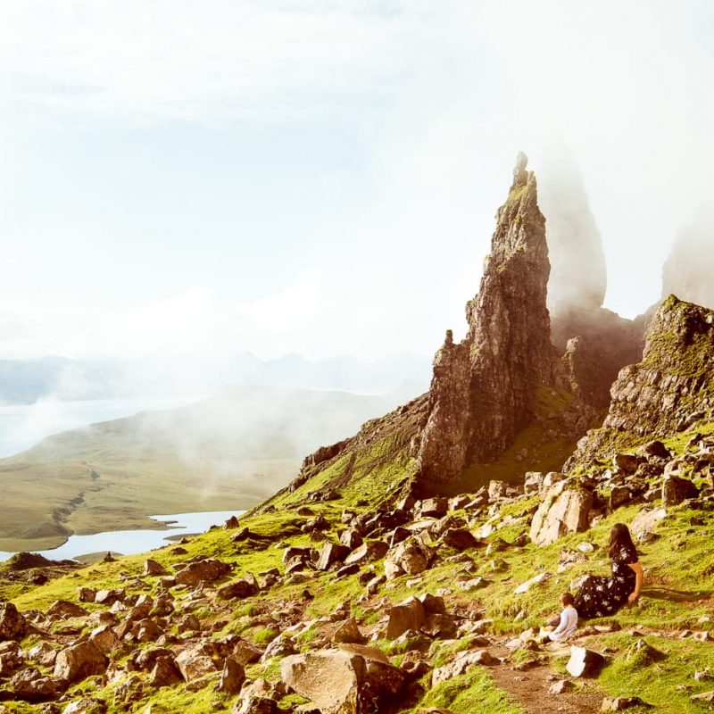 Resting in front of the Old Man of Storr on the Isle of Skye in Scotland