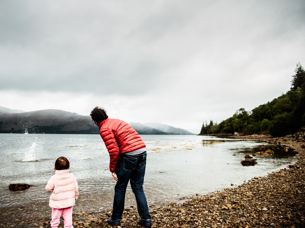 Jake and Lisa throwing stones into a Loch in Scotland