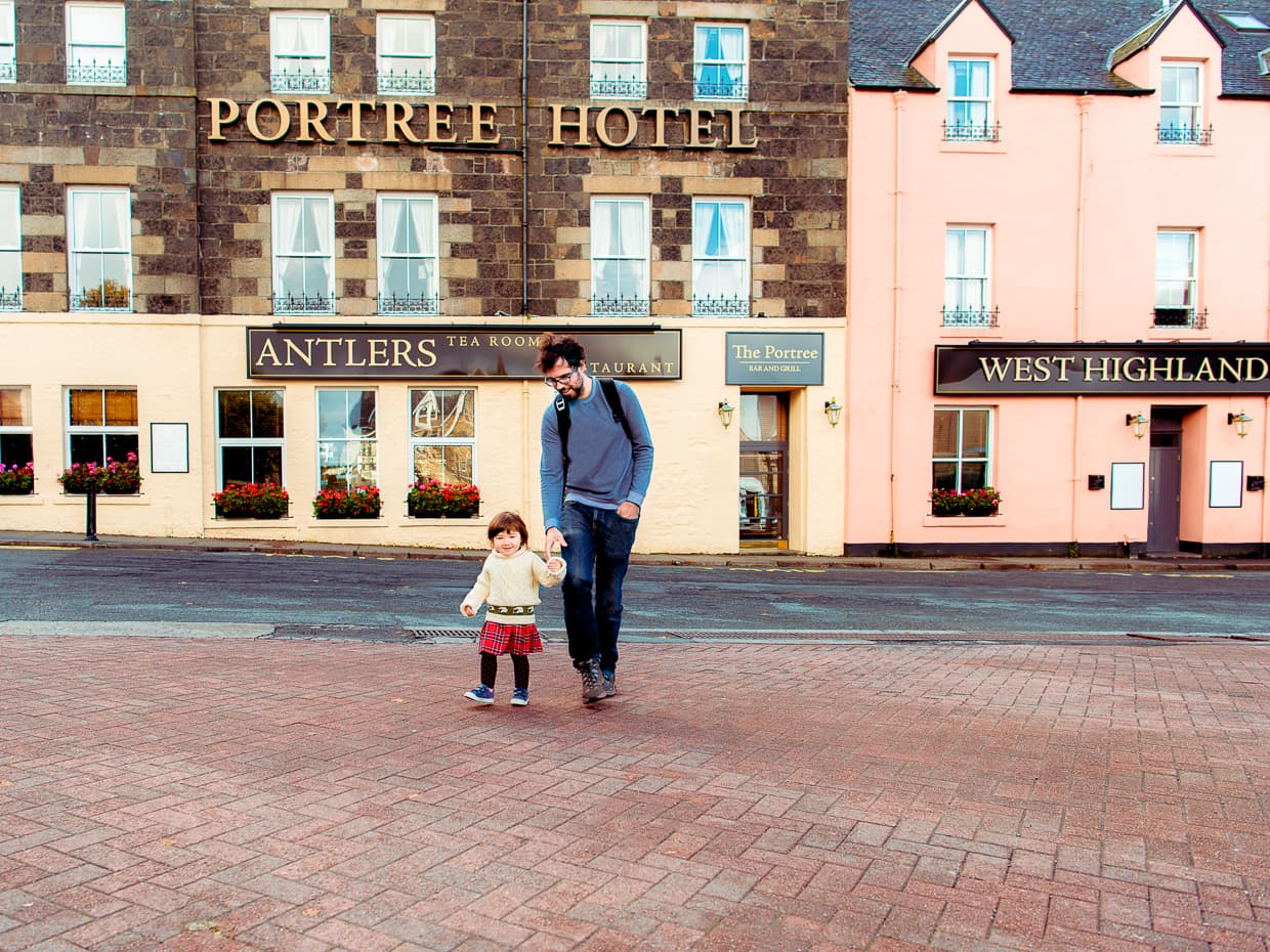 Lisa and Jake walking through the square in the center of Portree.