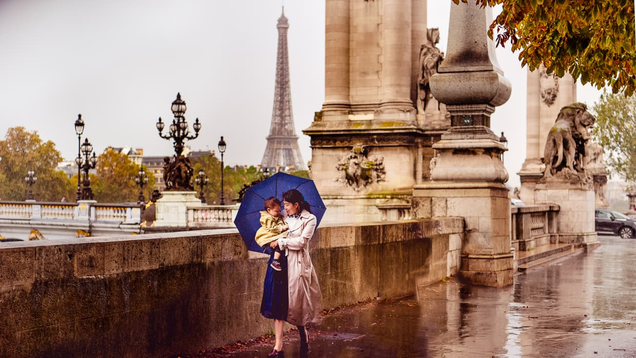Walking in the rain near pont Alexandre III. The Eiffel Tower looks tiny in the background.