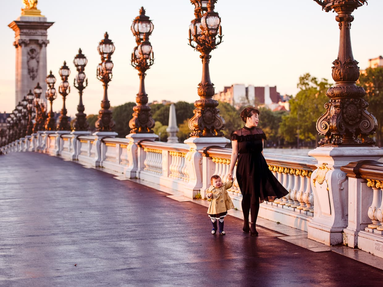 Walking along the lampposts on Paris' Pont Alexandre III at sunrise.