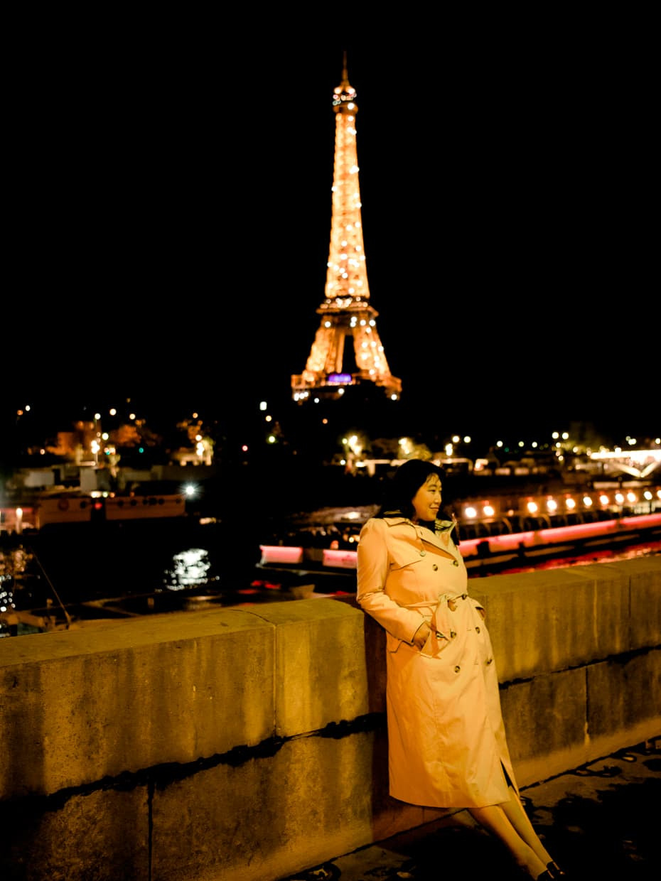 Standing in front of the Eiffel Tower at night on a cool autumn evening.