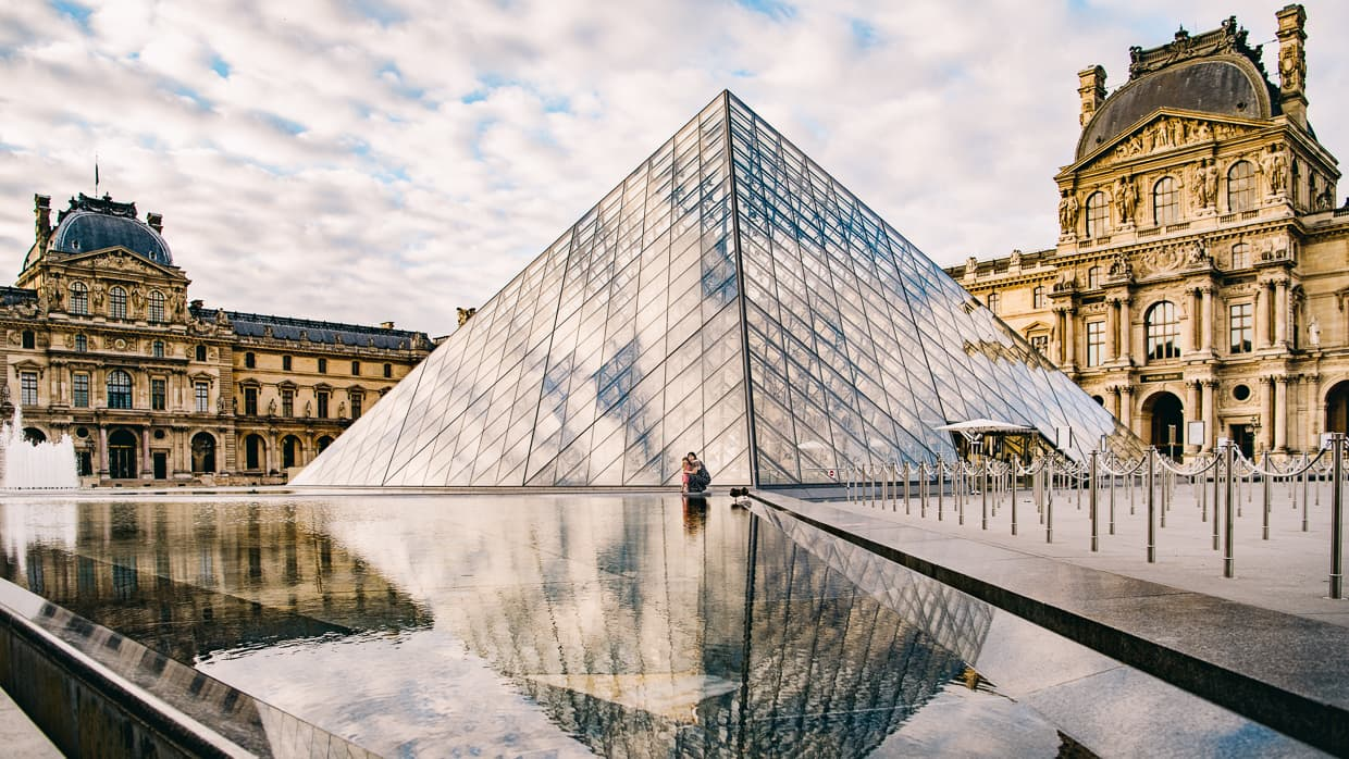 A reflection of the Louvre pyramid on a spring morning in Paris.