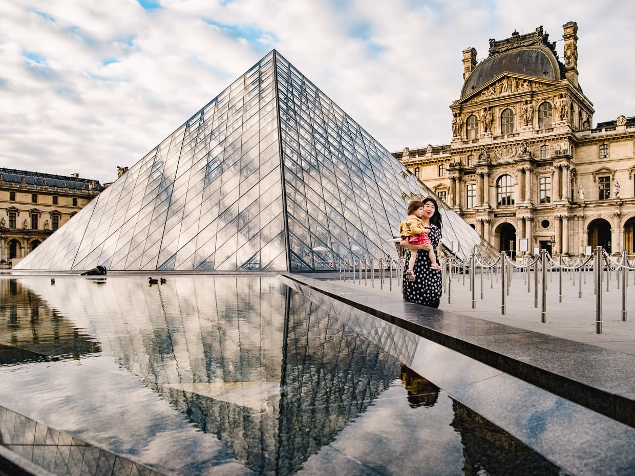 The Louvre pyramid on a spring morning, reflected in the pool.