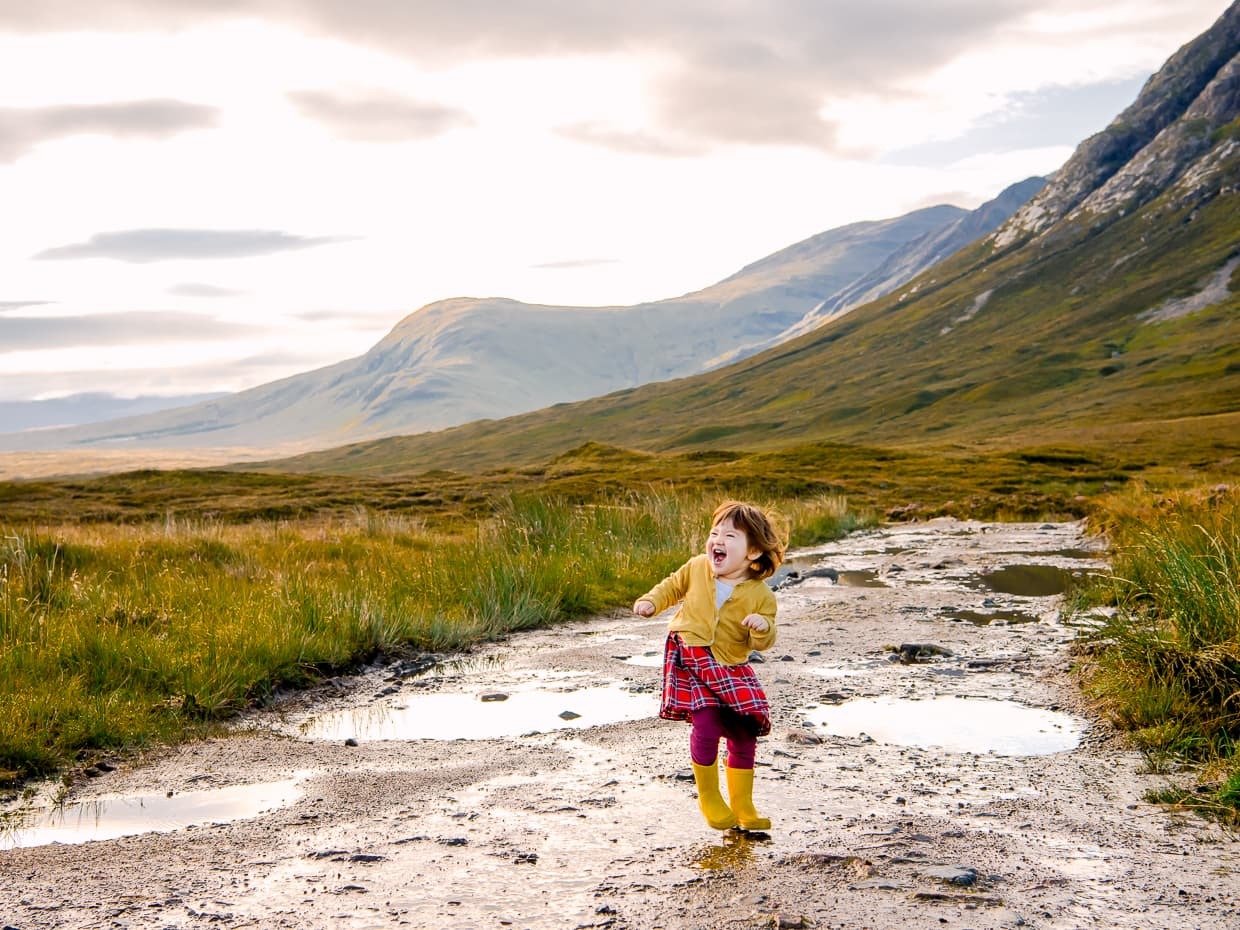 An expression of pure toddler joy on a dirt road in Glencoe Scotland.