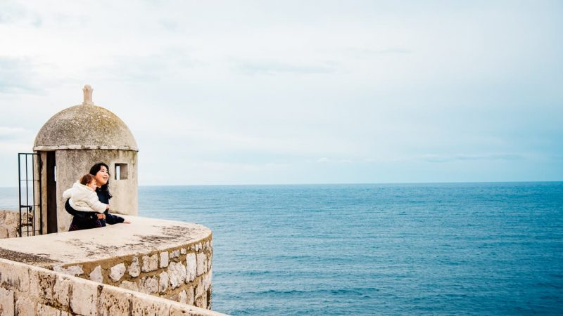 Enjoying the view of the Adriatic Sea beyond the city walls of Dubrovnik, Croatia.