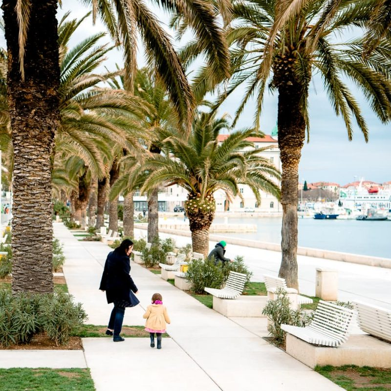 Walking down the waterfront promenade in Split, Croatia.