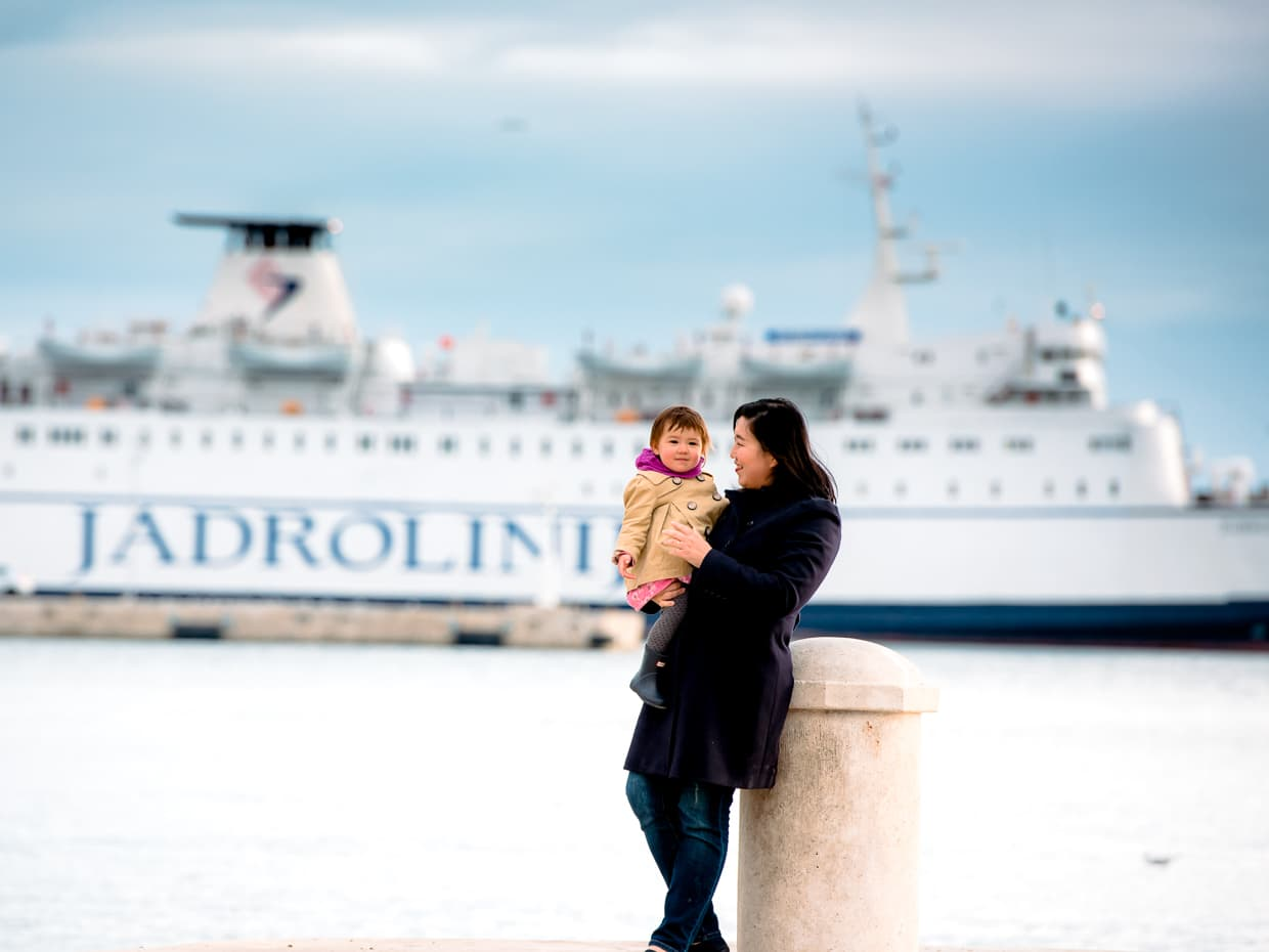 Posing in front of a Jadrolinija cruise ship in the Split, Croatia Harbor.