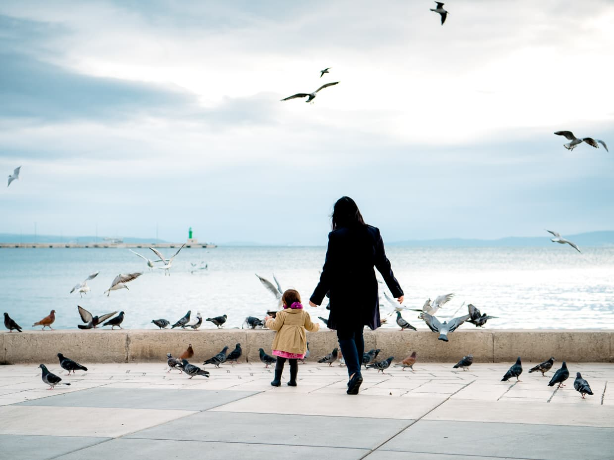 Chasing the birds on the promenade in Split, Croatia.