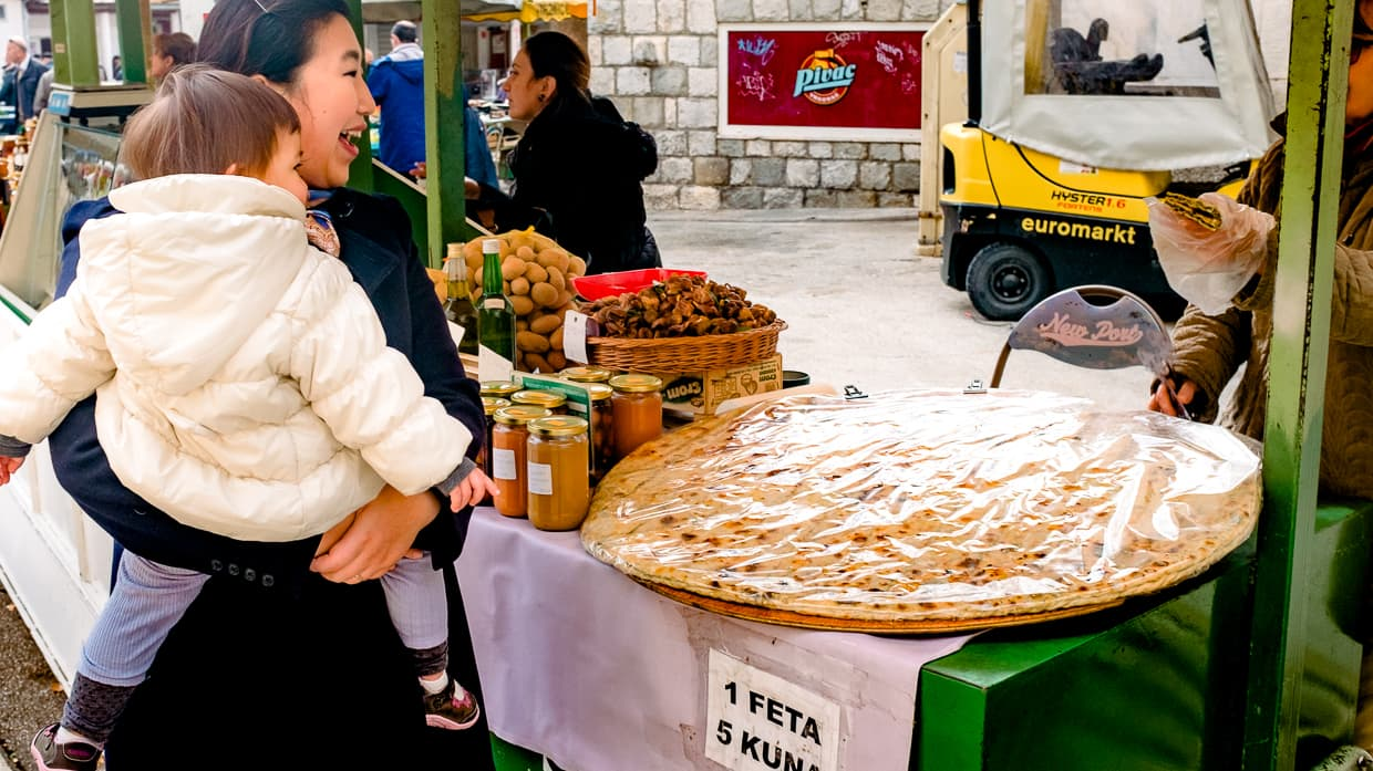 Buying bread at the farmer's market in Split, Croatia.
