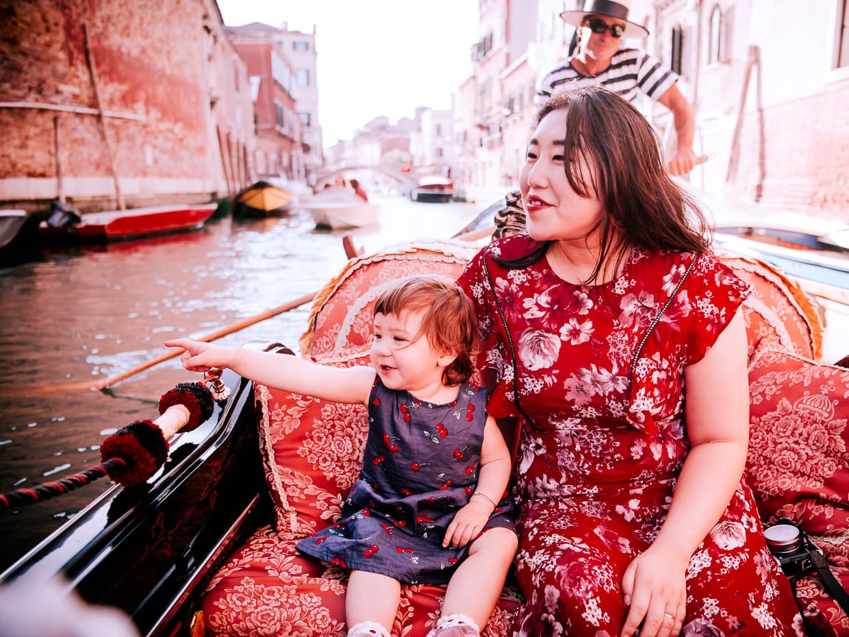 Pointing out the good angles of Venice on our gondola ride.