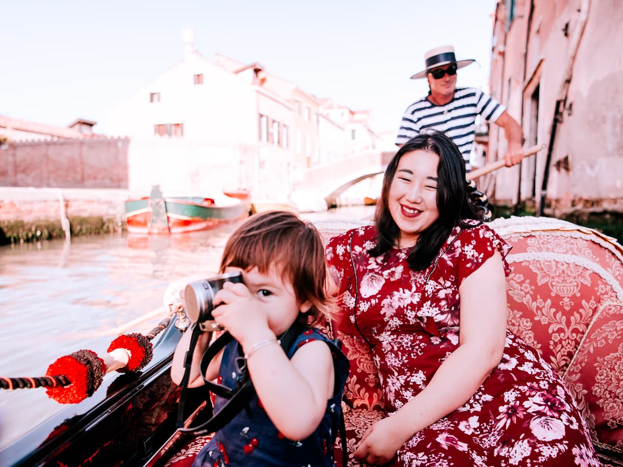 Taking photos like a tourist on our gondola tour of Venice.