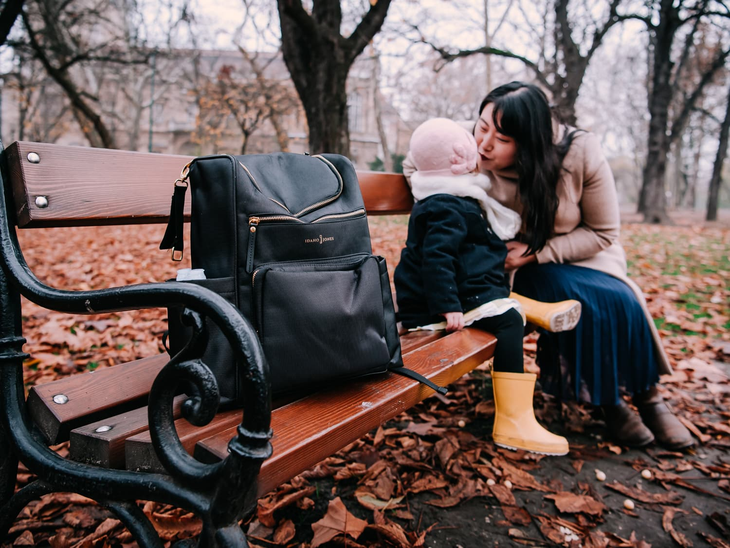 The Idaho Jones Gallivant Baby Changing Diaper Backpack on a park bench.