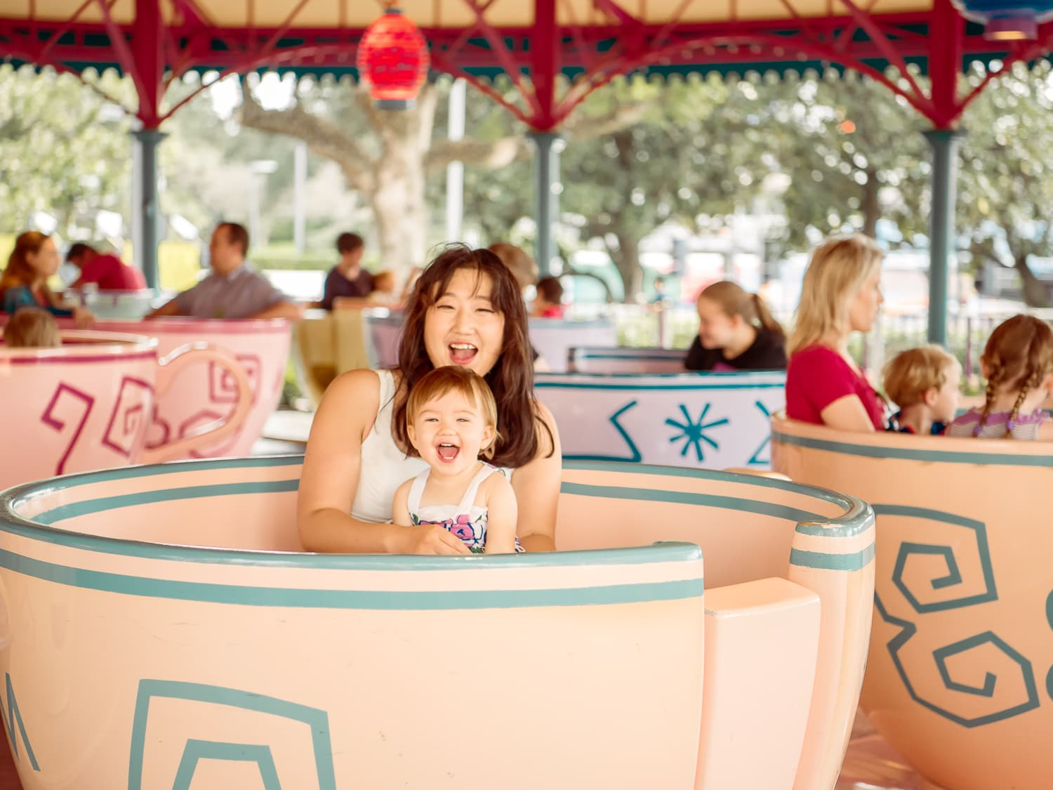 Lisa enjoying the Disney teacups a week before Christmas.