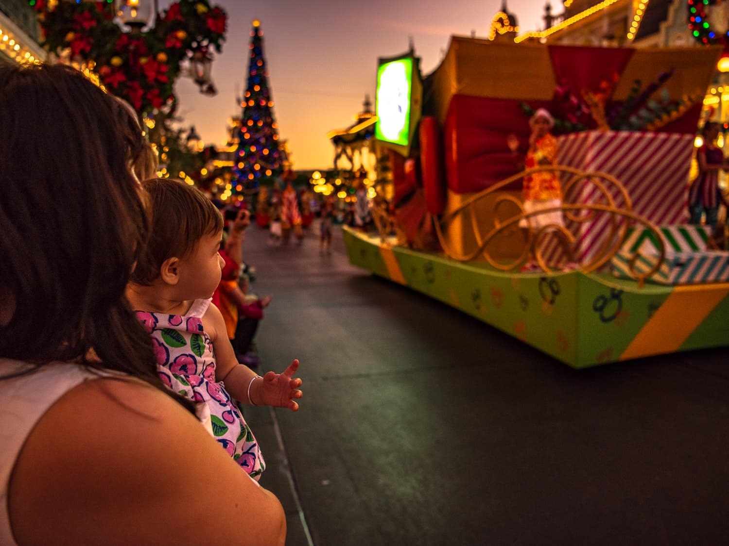 Lisa watching a Christmas parade on Main street USA at Magic Kingdom.