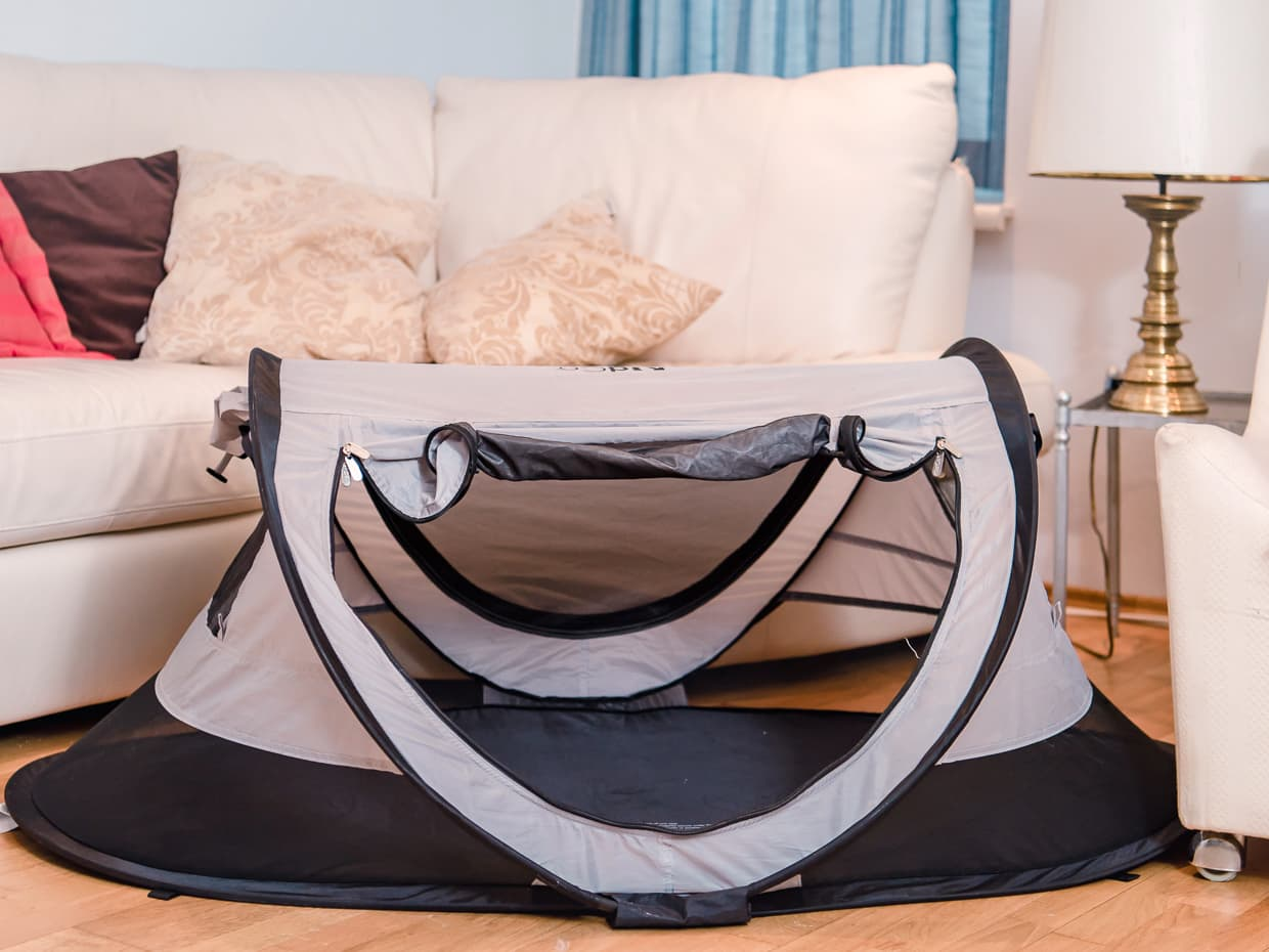 The Kidco Peapod Plus Baby Travel Tent with the flap open.
