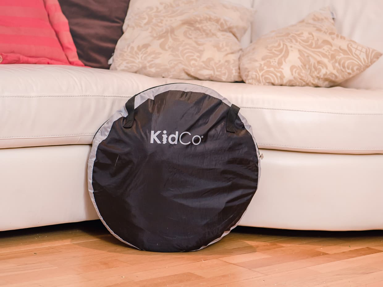 The Kidco Peapod Plus baby travel tent inside its bag.