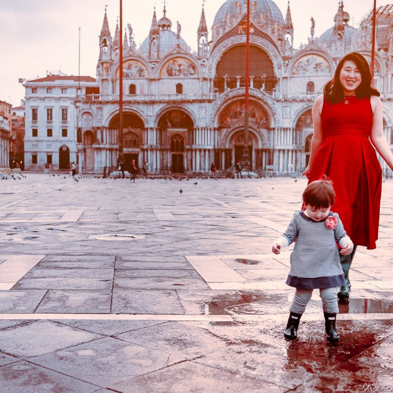 Playing in the puddles in Piazza San Marco in Venice, Italy.