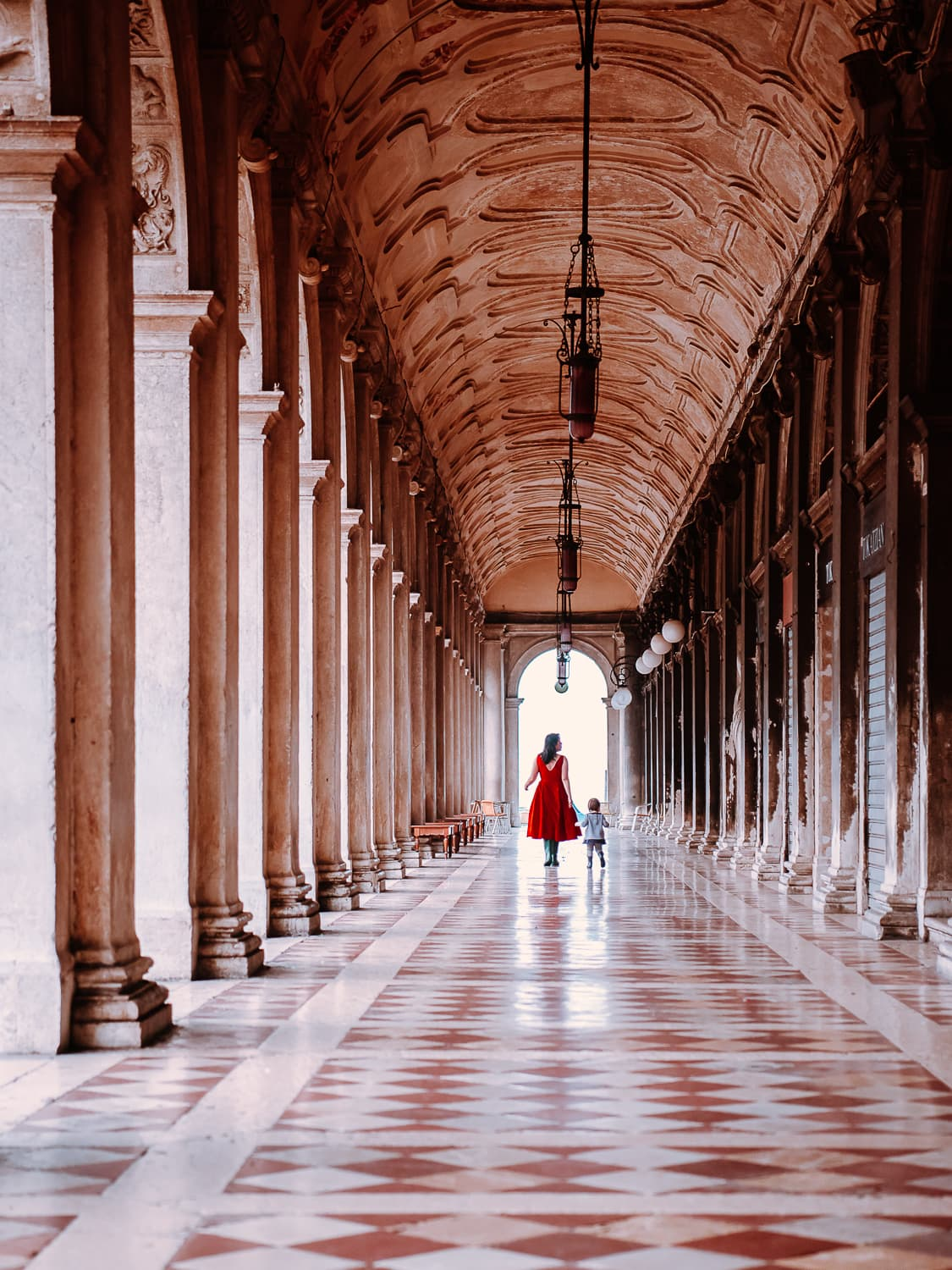 Beautiful tiled walkway with columns in Piazza San Marco in Venice, Italy.