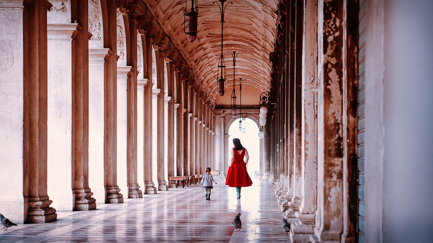 Walking amongst columns near Piazza San Marco.