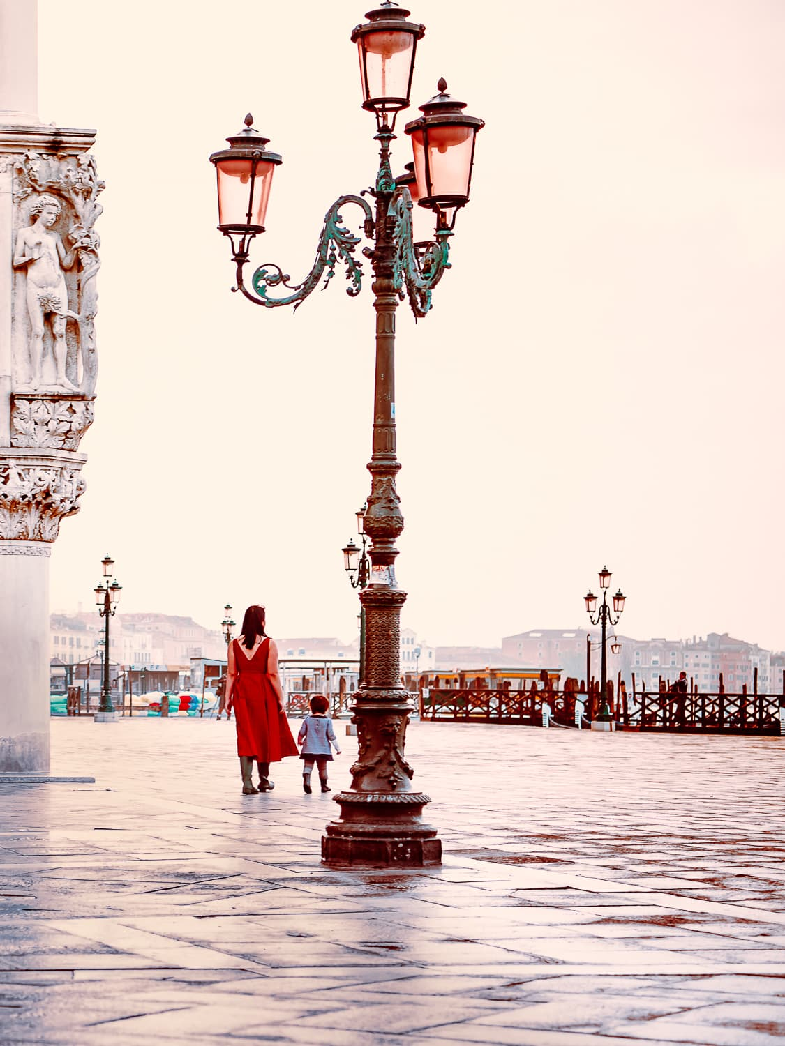 Iconic rose colored lamps outside the Doge's palace in Venice Italy.