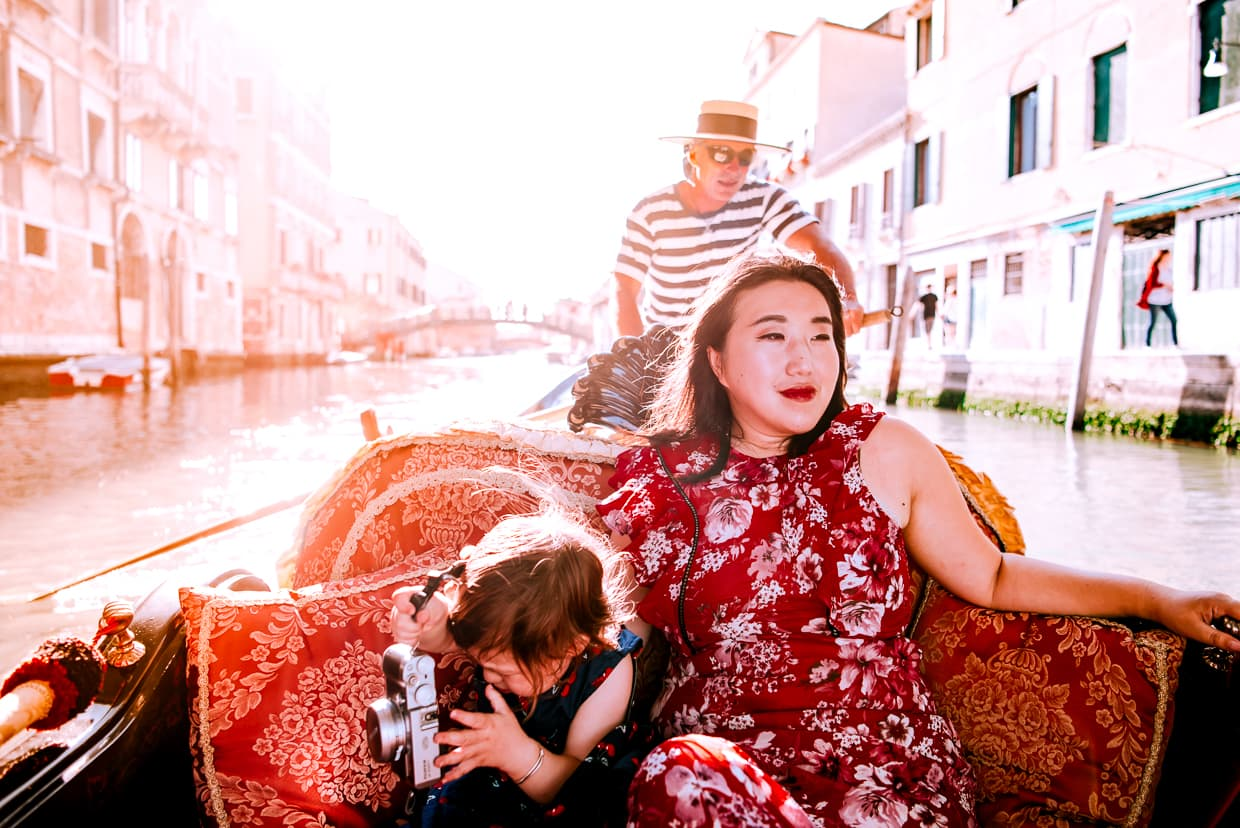 Toddler taking photos on a gondola ride.