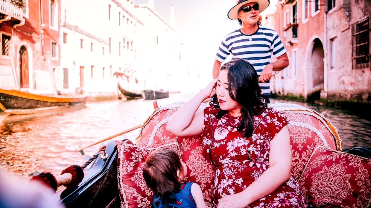 Dannie and Lisa going for a Venice gondola ride. I think the gondolier is singing in this photo.