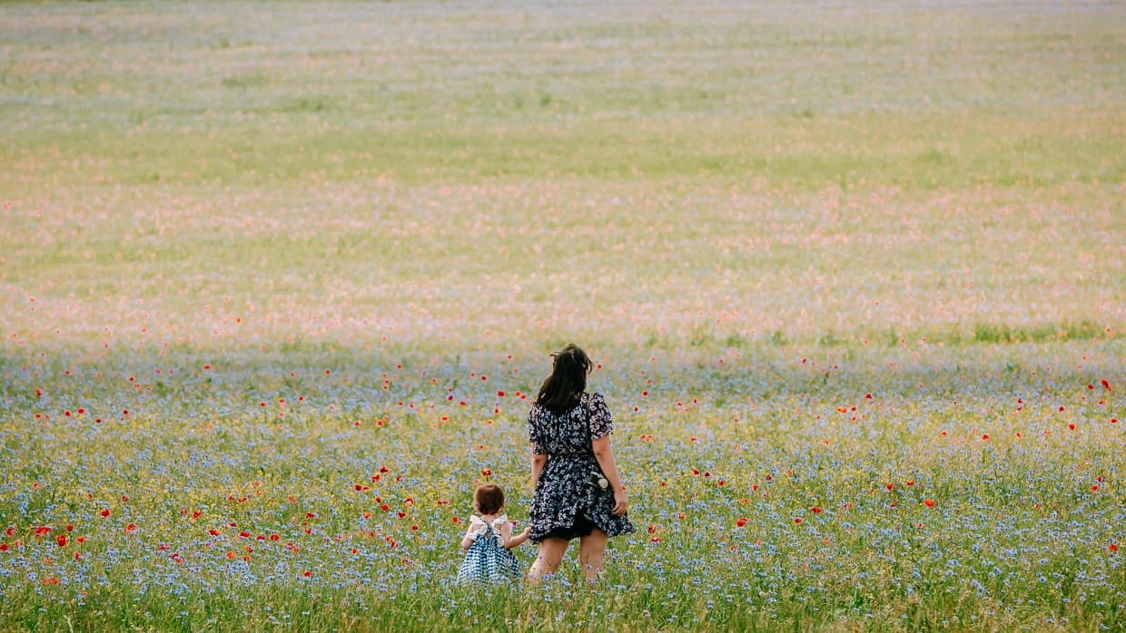 Dannie and Lisa in a giant field of wildflowers in Sault, France.