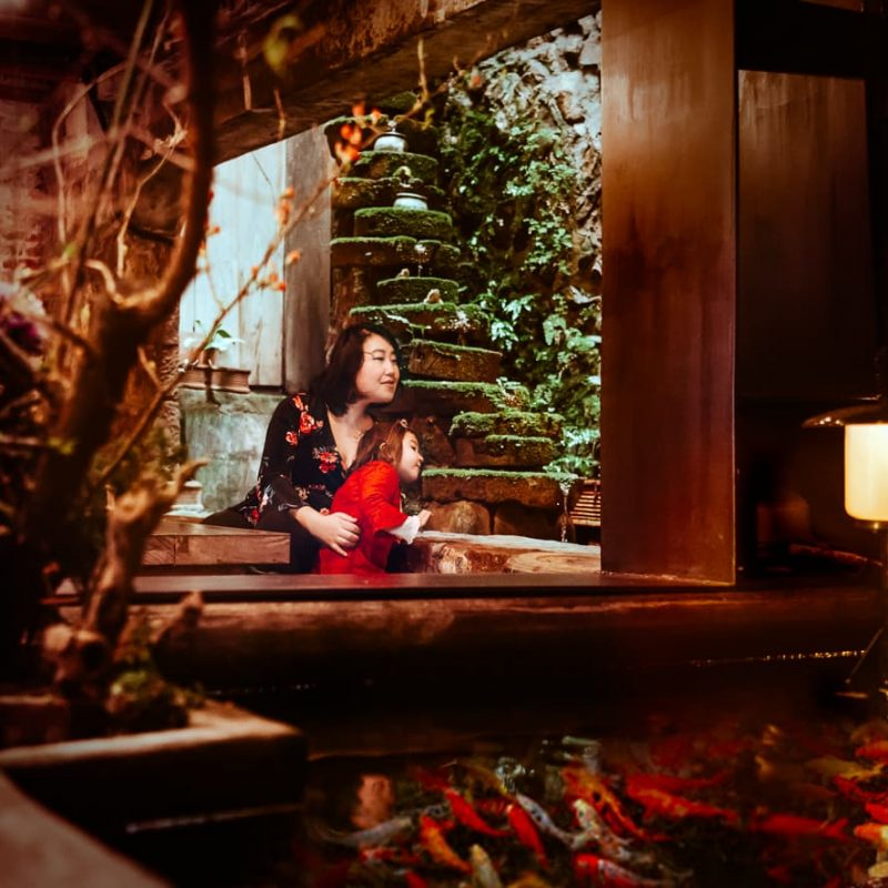 An indoor waterfall and koi pond in the Jiufen Taiwan Teahouse.