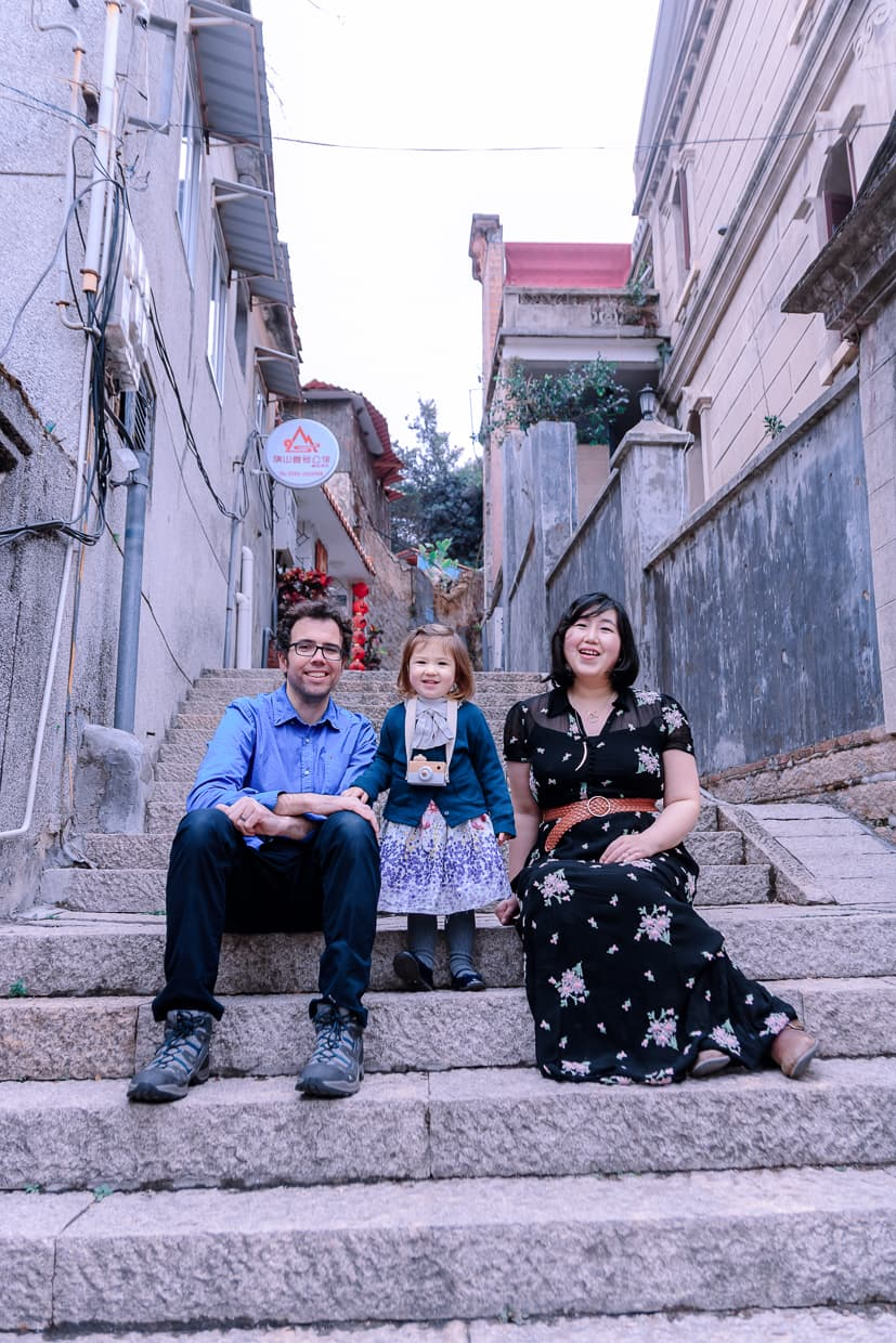 Sitting on a stairway on Gulangyu during our photoshoot in Xiamen, China.