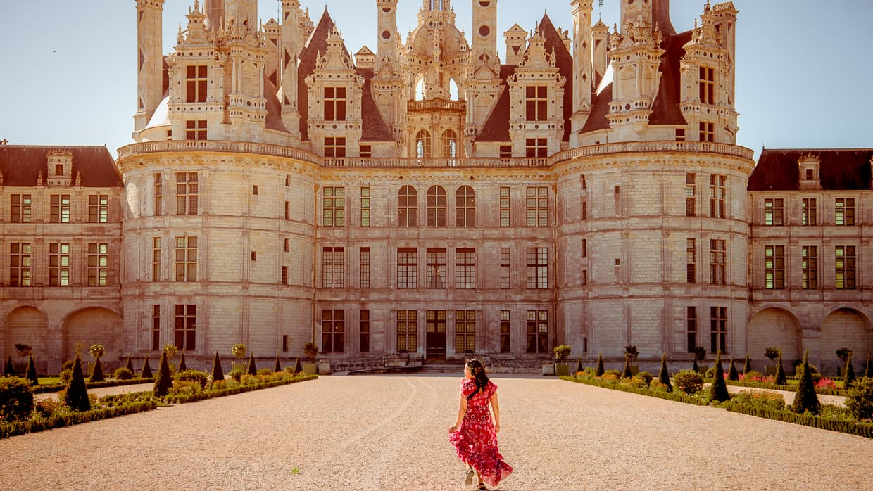 Exploring the French gardens of Chateau de Chambord in the Loire Valley.